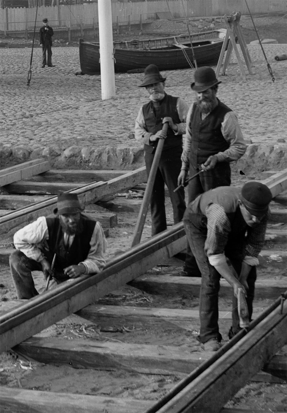Detail from one of our Lawrence Royal photographs - Men working at Belfast Docks laying a baulk road for the internal dock railway, circa 1890. NLI ref. LROY 02383