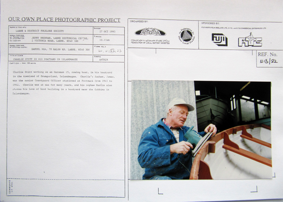 A card from the Our Own Place Photographic Project (taken on Wednesday, 27 October 1993 at 10.15am) showing Charlie Stitt working on an Oarsman 15 rowing boat, in his boatyard in the townland of Drumgurland, Islandmagee, Co. Antrim