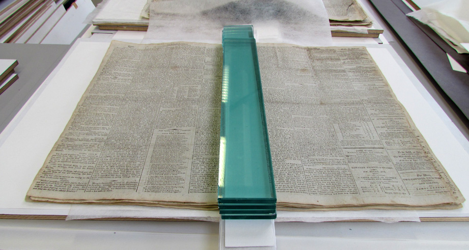 Drying of the Japanese paper repairs under weight